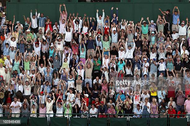 Crowds cheer as Nicolas Mahut and John Isner's match is stalled at 59 59 in the last set on Day Three of the Wimbledon Lawn Tennis Championships at...