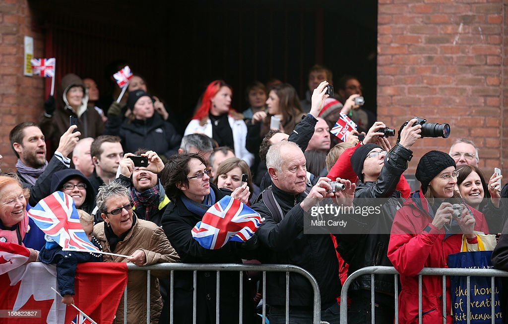 Crowds cheer as Queen Elizabeth II, accompanied by Prince Philip, Duke of Edinburgh arrive at the recently refurbished Bristol Old Vic Theatre on a visit to Bristol as part of her Jubilee tour on November 22, 2012 in Bristol, England.