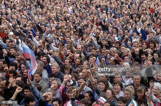 Crowds cheer as Russian President Boris Yeltsin speaks at the balcony of the Russian White House after a 1991 coup attempt is thwarted The State...
