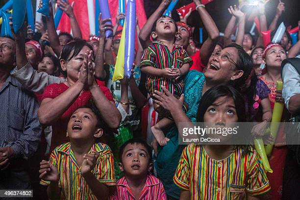 Crowds cheer as they gather for the election result announcement in front of the National League for Democracy's headquarters after Myanmar's first...