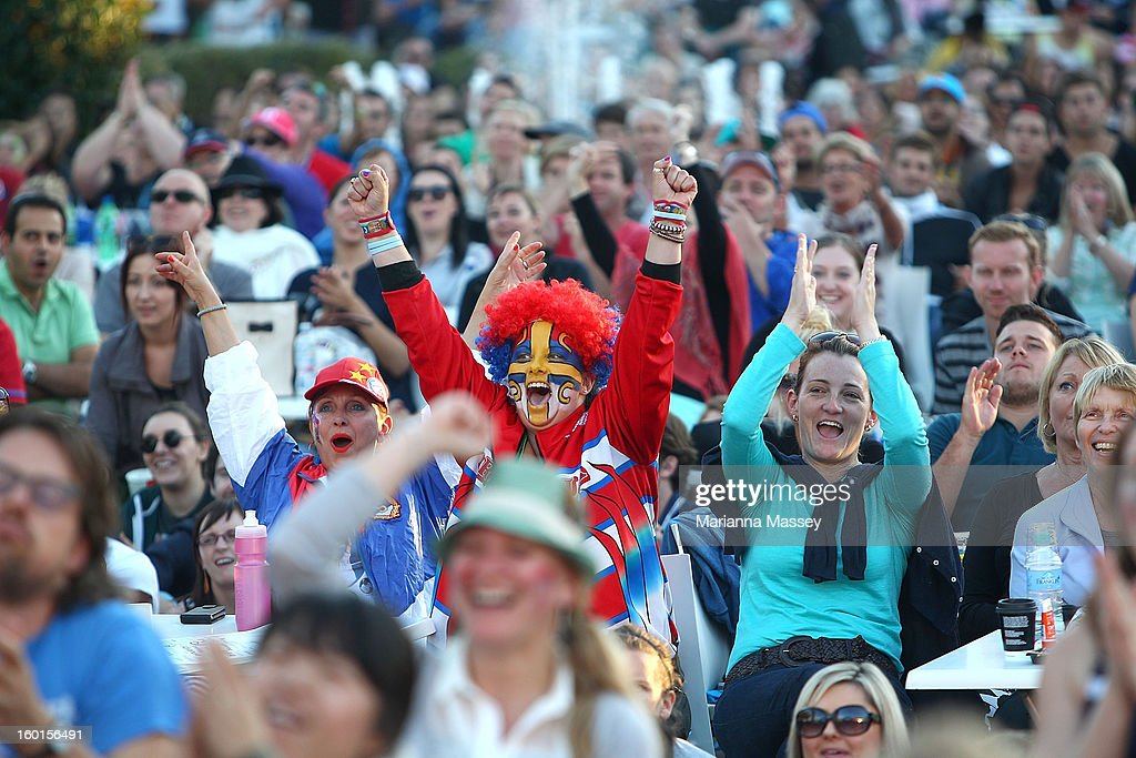 Crowds cheer during the men's final match at Garden Square during day fourteen of the 2013 Australian Open at Melbourne Park on January 27, 2013 in Melbourne, Australia.