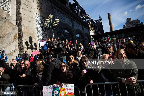 Crowds cheer for runners at the 59th Street Bridge during the TCS New York City Marathon on November 2 2014 in New York City