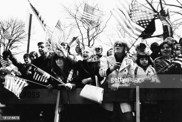 Crowds cheer from behind the police barrier on the 'Home With Honor' parade to mark the homecoming of American troops from Vietnam New York City 1973