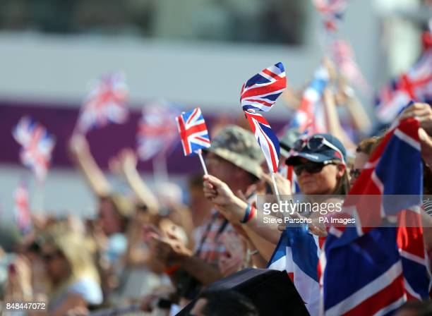 Crowds cheer on Great Britain's Charlotte Dujardin riding Valegro wins gold medal in the Equestrian Dressage Individual Grand Prix Freestyle at...