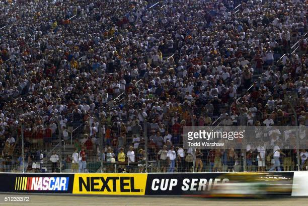 Crowds cheer on the drivers during the NASCAR Nextel Cup Series Sharpie 500 on August 27 2004 at Bristol Motor Speedway in Bristol Tennessee