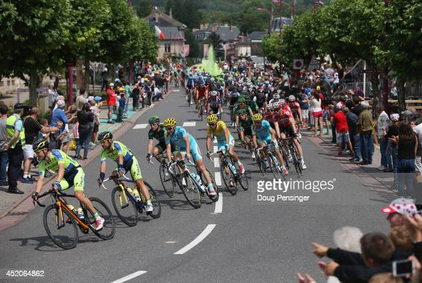 Crowds cheer the peloton during stage eight of the 2014 Le Tour de France from Tomblaine to Gerardmer La Mauselaine on July 12 2014 in Baccarat France