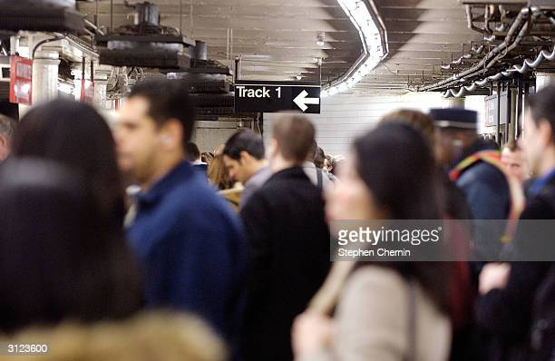 Crowds clog the Times Square subway station during rush hour despite the possibility of a terrorist attack March 23 2004 in New York City The US is...