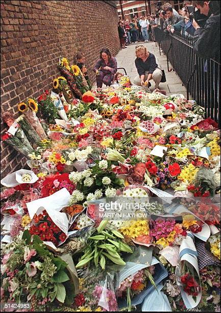 Crowds continue to place flowers outside Kensington Palace the home of the Princess of Wales 31 August after it was announced that Diana and her...
