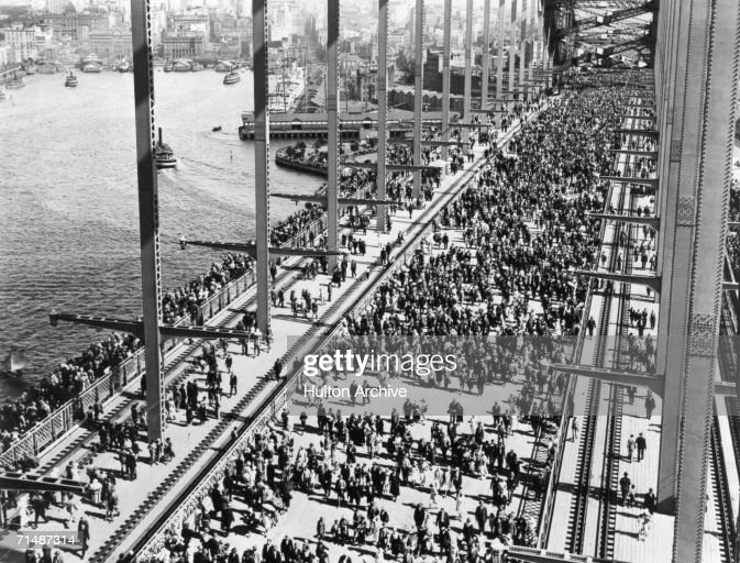 Crowds crossing Sydney Harbour Bridge for the opening celebration, 19th March 1932.