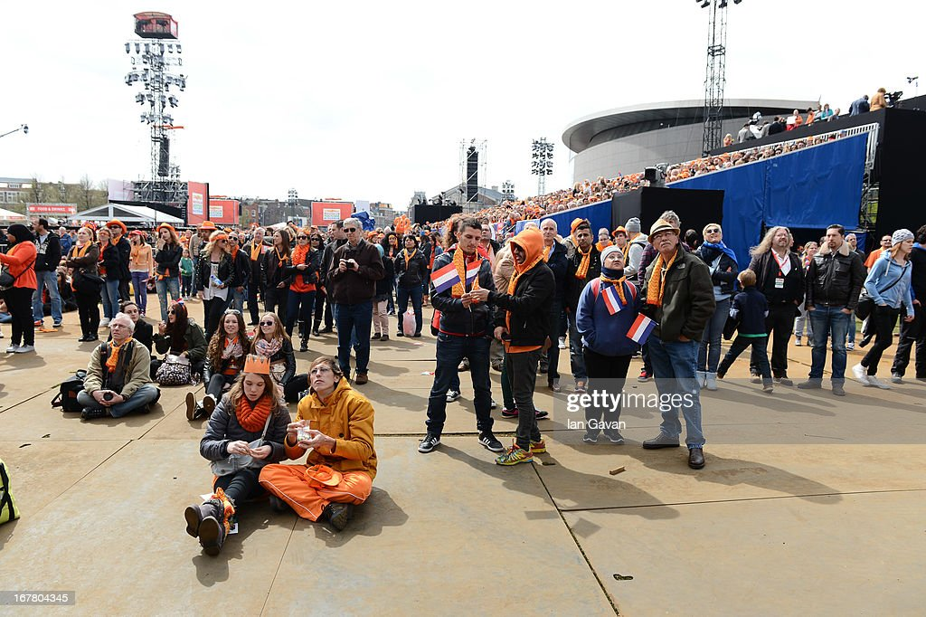 Crowds enjoy the atmosphere on Museumplien during the inauguration of King Willem Alexander of the Netherlands as Queen Beatrix of the Netherlands abdicates on April 30, 2013 in Amsterdam, Netherlands.