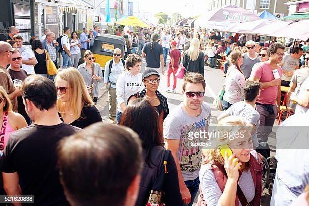 Crowds enjoying a street festival in a Cape Town suburb