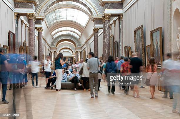 crowds enjoying the art of the Louvre