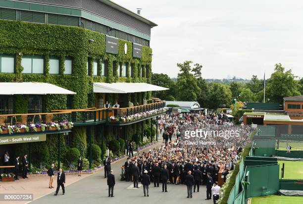 Crowds enter the grounds ahead of day one of the Wimbledon Lawn Tennis Championships at the All England Lawn Tennis and Croquet Club on July 3 2017...