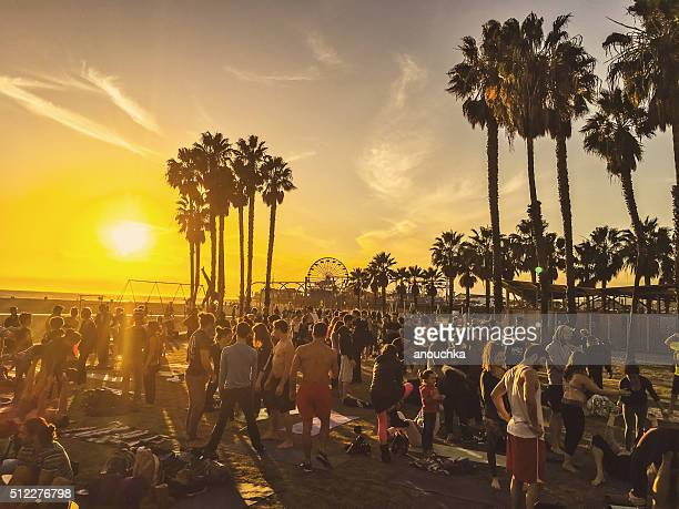 Crowds exercising on Santa Monica Muscle beach