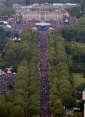 Crowds fill The Mall around Buckingham Palace ahead of The Diamond Jubilee flypast to celebrate the Queen's Diamond Jubilee in London on June 5 2012...