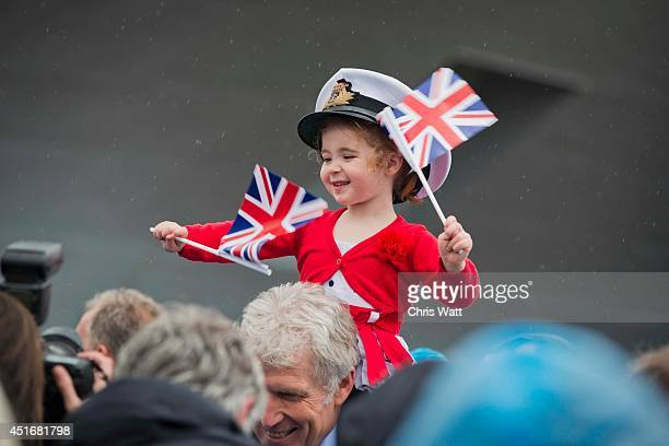 Crowds gather ahead of Queen Elizabeth II officially naming the Royal Navy's new aircraft carrier HMS Queen Elizabeth on July 4 2014 in Rosyth...