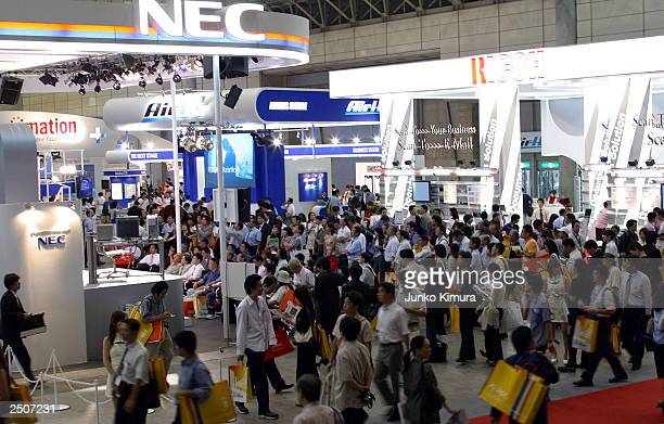 Crowd's gather around NEC's stand during Asia's biggest digital exhibition WPC Navi Expo 2003 on September 18 2003 in Makuhari Japan 300000 people...
