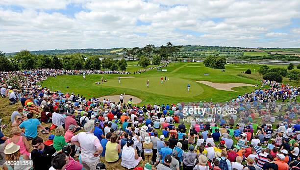 Crowds gather around the 7th green for the Harrington McIlroy and Gallacher group during the second round of the Irish Open at the Fota Island Resort...