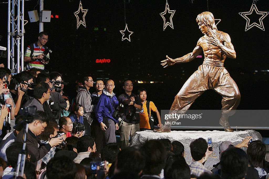 Crowds gather around the bronze statue of late martial arts legend and movie superstar Bruce Lee after a unveiling ceremony at Avenue of Stars on November 23, 2005 in Hong Kong. The ceremony is part of Bruce Lee Festival to celebrate the star's 65th birthday. Bruce was died in 1973 at the age of 32.