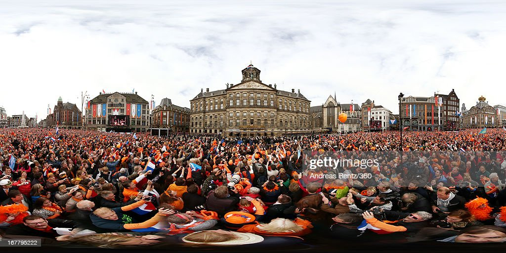 Crowds gather as King Willem-Alexander of the Netherlands, Queen Maxima of the Netherlands and their daughters Princess Catharina Amalia, Princess Ariane and Princess Alexia of the Netherlands appear on the balcony of the Royal Palace to greet the public after the abdication of Queen Beatrix of the Netherlands on April 30, 2013 in Amsterdam, Netherlands.