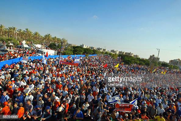 Crowds gather as opponents to Israeli Prime Minister Ariel Sharon's disengagement plan attend a protest on July 18 Netivot Israel More than 20000...