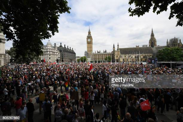 Crowds gather as they wait for Labour Party leader Jeremy Corbyn to speak during the 'Not One Day More' march at Parliament Square on July 1 2017 in...