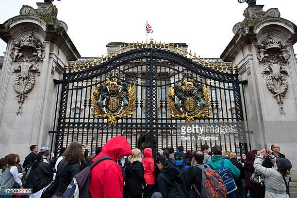 Crowds gather at the front gate of Buckingham Palace after the Duke and Duchess of Cambridge yesterday welcomed their newborn baby daughter on May 3...