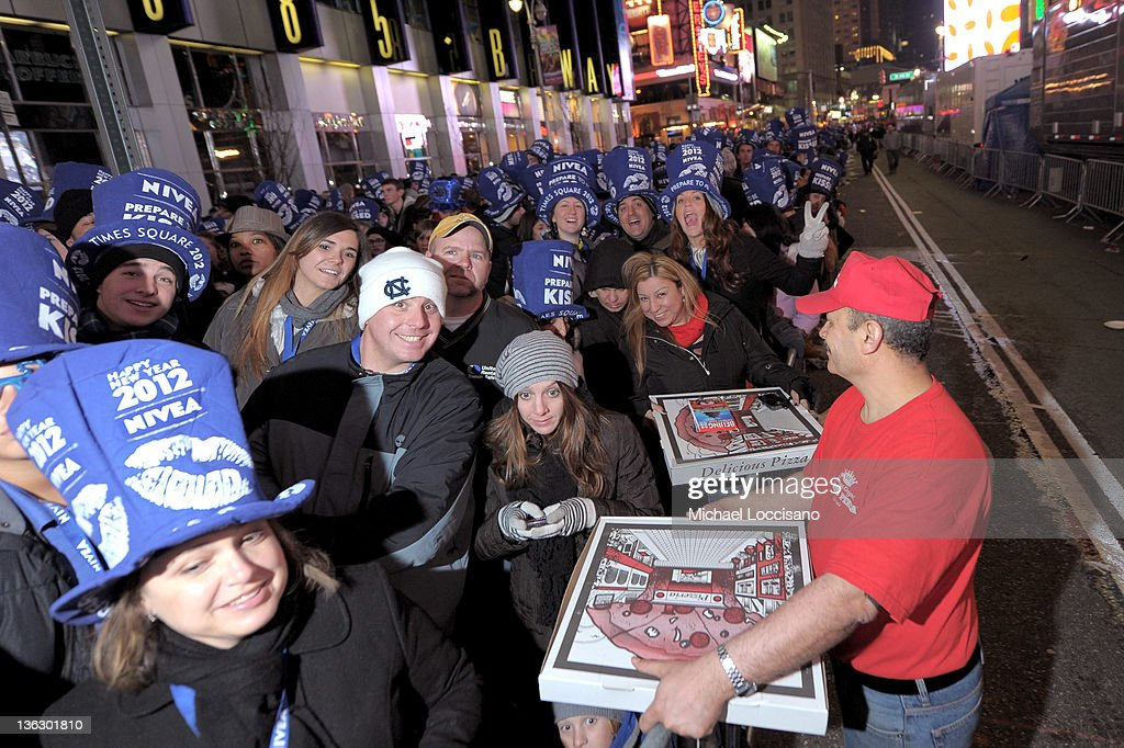 Crowds Gather For New Year's Ball Drop In Times Square on December 31, 2011 in New York City.