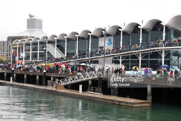 Crowds gather in the Viaduct Basin during the Team New Zealand Americas Cup Welcome Home Parade on July 6 2017 in Auckland New Zealand