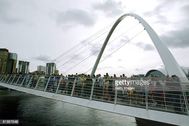 Crowds gather on the Millenium Bridge during The Great North Run September 25 2004 in Newcastle England