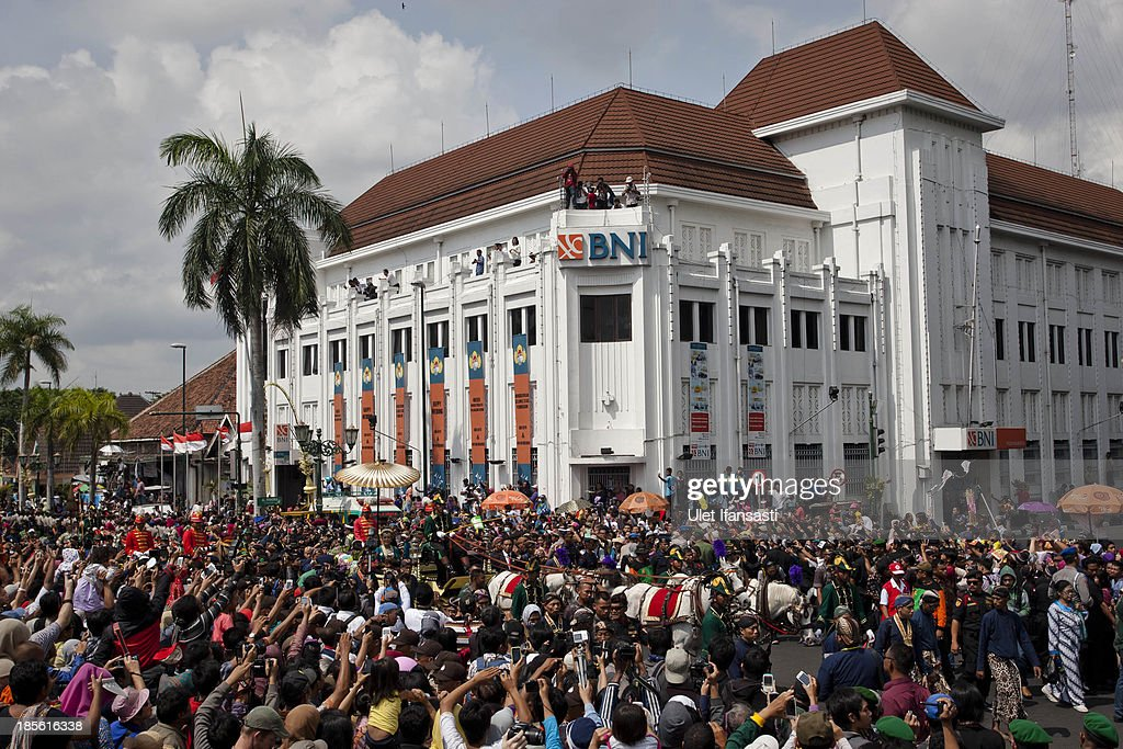 Crowds gather on the street during the wedding ceremony parade as part of the Royal Wedding Held For Sultan Hamengkubuwono X's Daughter Gusti Ratu Kanjeng Hayu And KPH Notonegoro on October 23, 2013 in Yogyakarta, Indonesia. Wedding celebrations will take place between October 21st and 23rd. The wedding parade will include 12 royal horse drawn carriages and will be streamed live on the internet so that it can be watched by people all over the world.