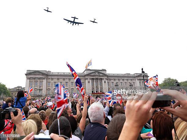 Crowds gather outside Buckingham Palace after the Royal Wedding of Prince William to Catherine Middleton on April 29 2011 in London England The...