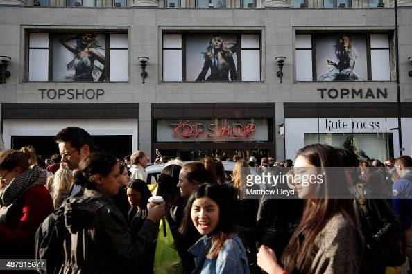 Crowds gather outside the flagship Topshop store on Oxford Circus in anticipation of the launch of Kate Moss' new clothing collection on April 29...