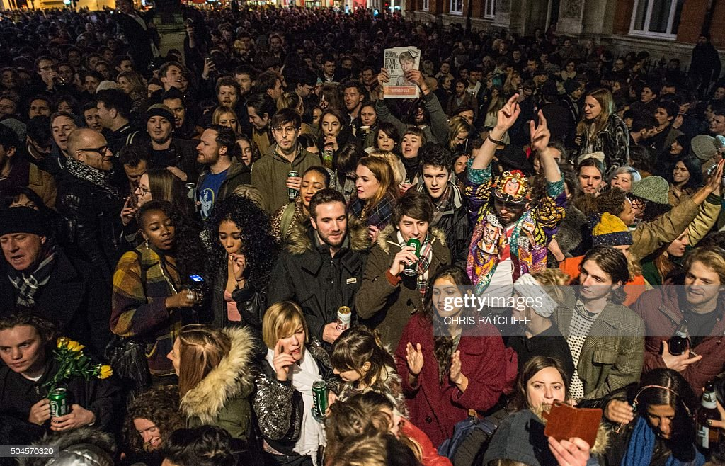 Crowds gather outside the Ritzy cinema in south London to pay homage to British singer <a gi-track='captionPersonalityLinkClicked' href=/galleries/search?phrase=David+Bowie&family=editorial&specificpeople=171314 ng-click='$event.stopPropagation()'>David Bowie</a> following the announcement of Bowie's death on January 11, 2016. British music icon <a gi-track='captionPersonalityLinkClicked' href=/galleries/search?phrase=David+Bowie&family=editorial&specificpeople=171314 ng-click='$event.stopPropagation()'>David Bowie</a> died of cancer at the age of 69, drawing an outpouring of tributes for the innovative star famed for groundbreaking hits like 'Ziggy Stardust' and his theatrical shape-shifting style. RATCLIFFE
