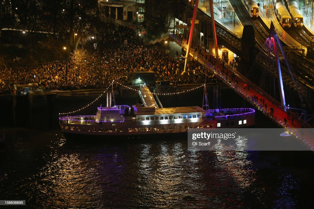 Crowds gather to celebrate New Year's Eve on the Embankment on December 31, 2012 in London, England. Thousands of people are lining the banks of the River Thames near Parliament in central London. A fireworks display at midnight will herald the start of 2013.