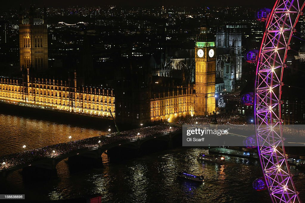 Crowds gather to celebrate New Year's Eve on Westminster Bridge on December 31, 2012 in London, England. Thousands of people are lining the banks of the River Thames near Parliament in central London. A fireworks display at midnight will herald the start of 2013.