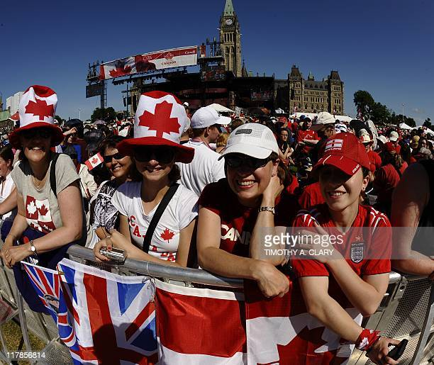 Crowds gather to get a glimpse of Prince William and his wife Catherine the Duchess of Cambridge arriving on Parliament Hill on Ottawa during Canada...