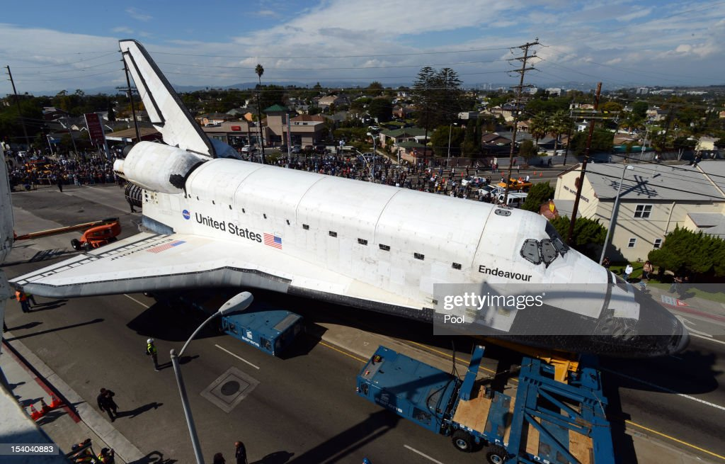 Crowds gather to get a glimpse of the Space Shuttle Endeavour at the corner of La Tijera Blvd. and Manchester Blvd., as it is transported to California Science Center on October 12, 2012 in Los Angeles, California.
