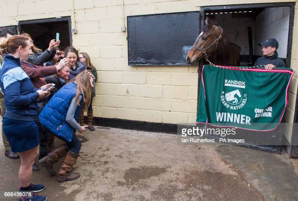 Crowds gather to see Grand National winner One For Arthur at trainer Lucinda her yard in Kinross Scotland
