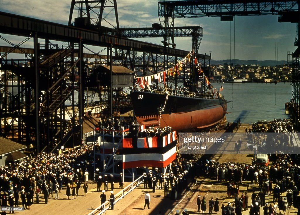 Crowds gather to watch the launch of the American military submarive, the USS Swordfish at the Mare Island Naval Shipyard, Vallejo, California, April 3, 1939.