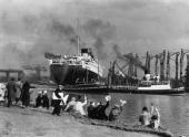 Crowds gather to watch the new Cunard White Star liner Queen Mary leaving her fittingout berth in the John Brown Co shipyard at Clydebank...