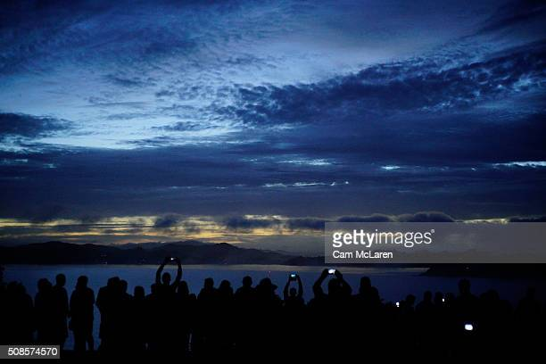 Crowds gather to watch the sun rise over Waitangi after the dawn service on February 6 2016 in Waitangi New Zealand The Waitangi Day national holiday...
