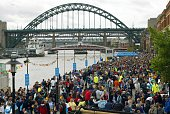 Crowds gather with the Tyne Bridge in the background during The Great North Run September 25 2004 in Newcastle England