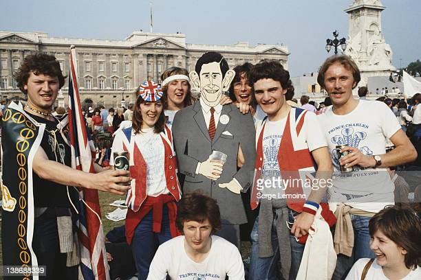 Crowds in front of Buckingham Palace in London celebrate the wedding of Prince Charles to Lady Diana Spencer UK 29th July 1981 Several of them are...