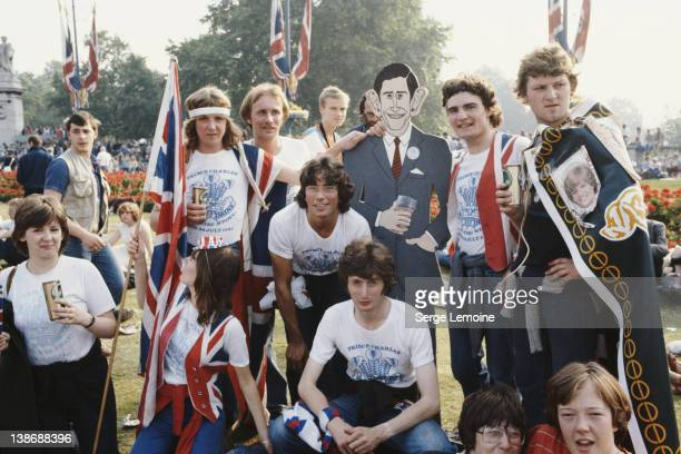 Crowds in London celebrate the wedding of Prince Charles to Lady Diana Spencer UK 29th July 1981 Several of them are wearing tshirts commemorating...