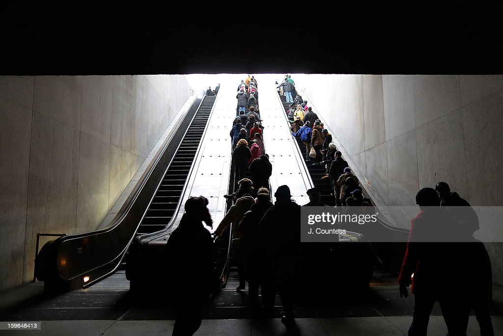 Crowds in route to the National Mall depart the L'Enfant Plaza Metro station to watch the 57th United States Presidential Inauguration ceremony on January 21, 2013 in Washington, DC.