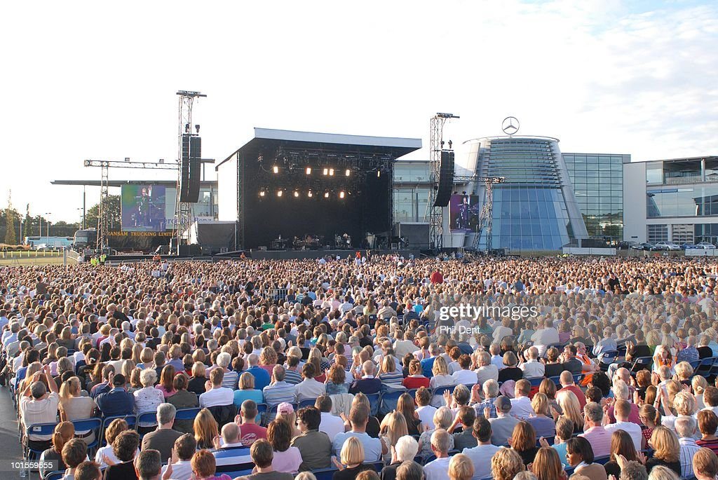 Crowds in the audience watching Elton John perform on stage at Mercedes-Benz World on 13th July 2008 in Weybridge, Surrey, United Kingdom.