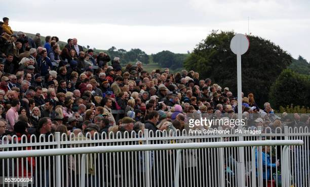 Crowds in the grandstand at Cartmel Racecourse Cartmel Cumbria