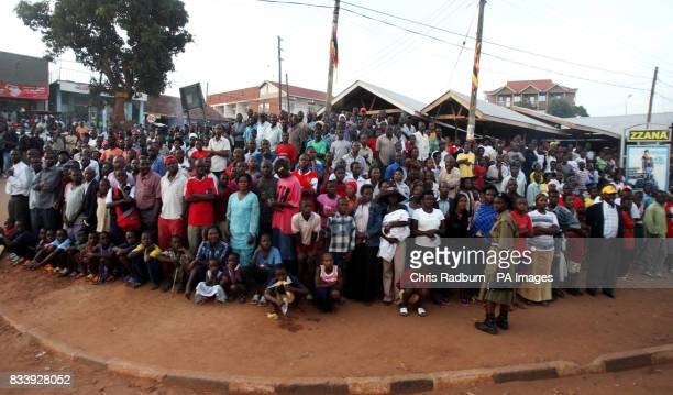 Crowds line the route for Britains Queen Elizabeth II between Entebbe and Kampala after her arrival in Uganda for the start of a four day visit to...