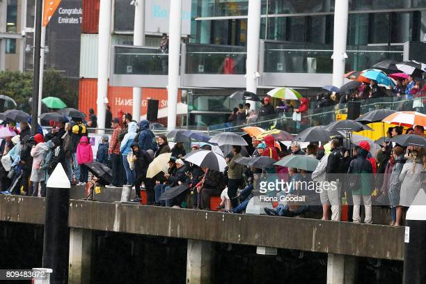 Crowds line the Viaduct Basin during the Team New Zealand Americas Cup Welcome Home Parade on July 6 2017 in Auckland New Zealand